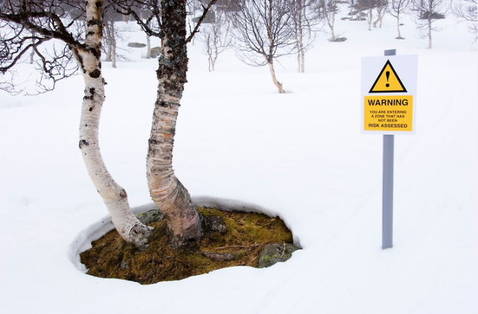 Spoof hazard sign in the forest by Niall Benvie